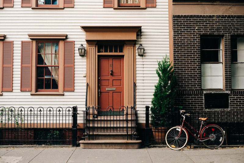 Fenced home with a bike in front