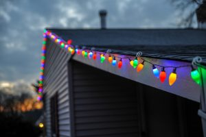 Christmas lights on a house at sunset