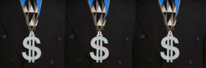 Man in suit wearing a dollar sign necklace