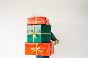 Person holding wrapped presents