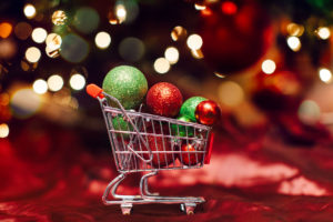 Tiny shopping cart filled with Christmas ornaments