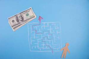 Illustration of a maze leading to money