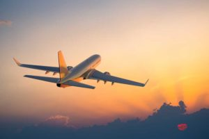 Passenger airliner flying into the sunset
