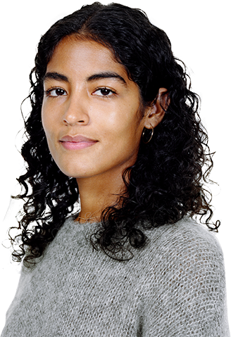http://Portrait%20of%20a%20young%20female%20with%20black%20curly%20hair