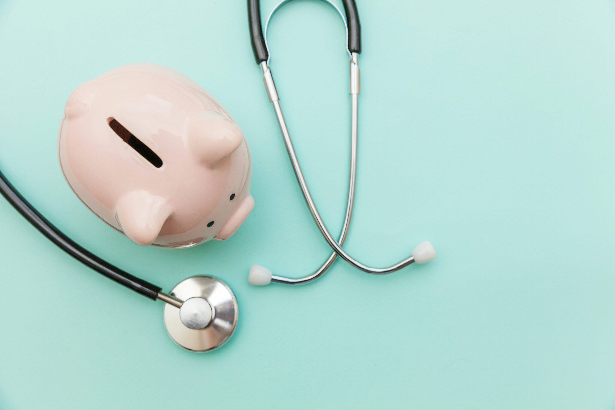 Piggy bank and a stethoscope