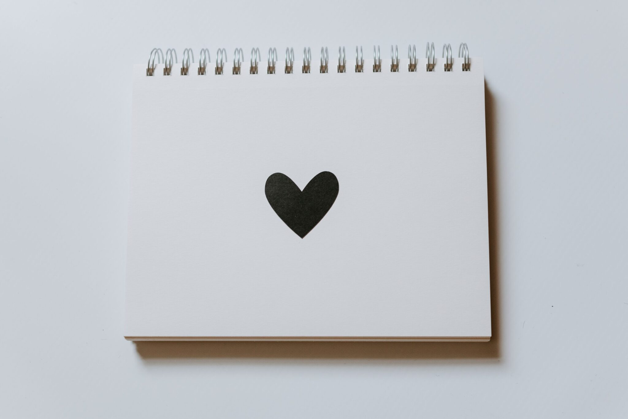 A notebook with a black heart on the cover