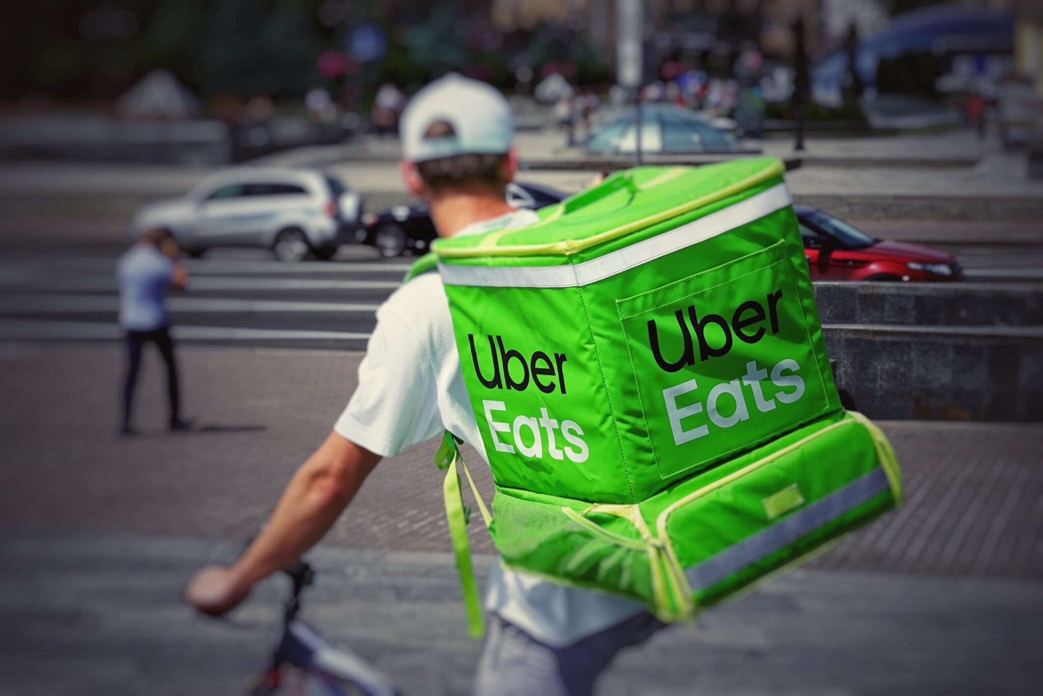An Ubereats delivery person on a bike