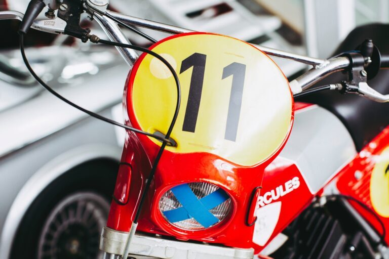 A red motorcycle with the number 11 on the front