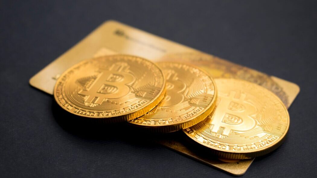 Three Bitcoins sitting on a credit card