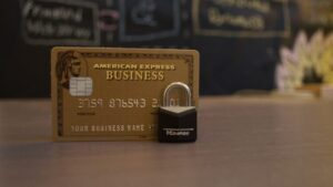 An American Express Business card and a lock