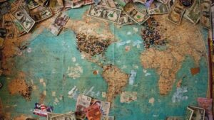 A map of the world with different currencies pinned to it