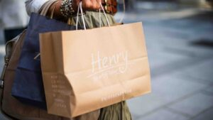 Closeup of a person carrying a purse and shopping bags