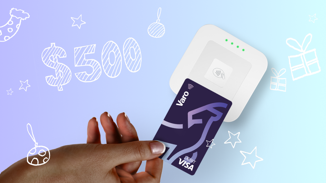 A Varo debit card held over a touchless card reader