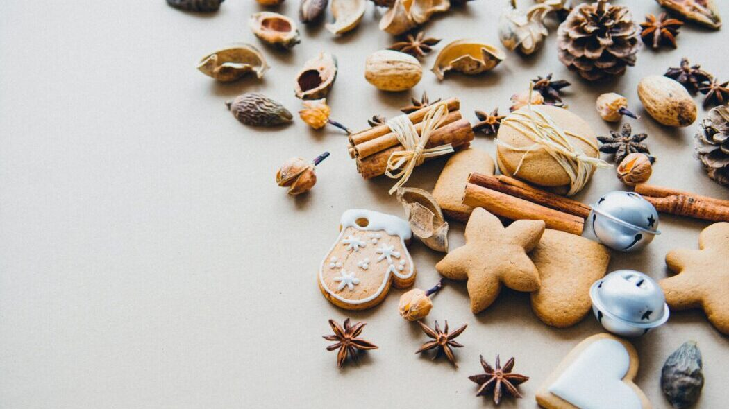 Pinecones, nuts, cinnamon and cookies on a table