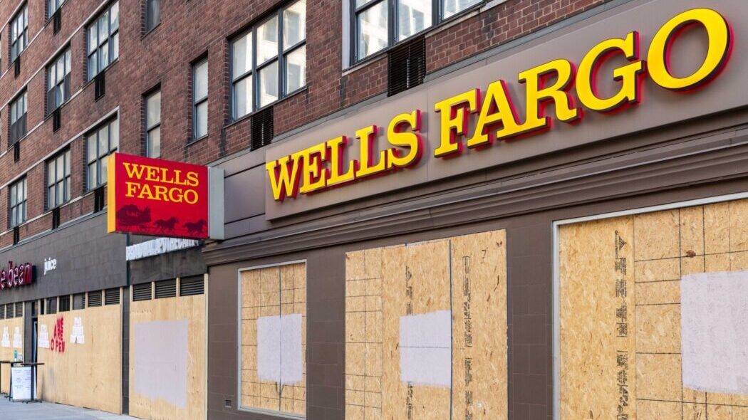 A boarded up Wells Fargo storefront