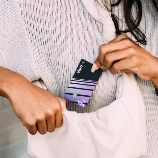 person holding varo card